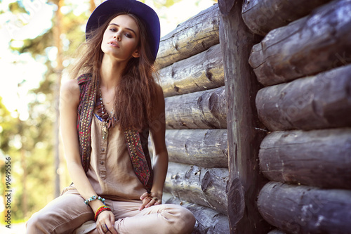 Poster Outdoor fashion portrait of young beautiful woman. Boho chic sty