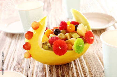 Colorful display of fresh fruit salad in a boat