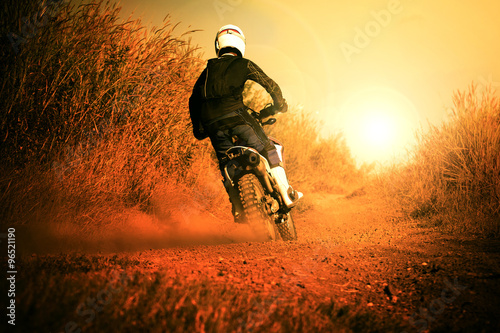 man riding motorcycle in motorcross track use for people activit