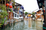 Old village by river in Shanghai with boat..
