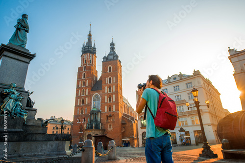 Tourist photographing in the center of Krakow