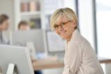 Fototapety Senior businesswoman standing in office