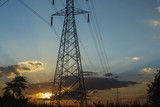High voltage pole, Transmission line tower with sunset.