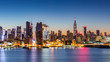 New York City skyline at dawn, as viewed from Weehawken, along the 42nd street canyon