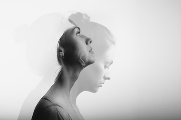 Double exposure with young and beautiful girl, monochrome
