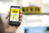 Fototapety Person Booking Taxi On Smart Phone