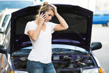 Woman Using Mobile Phone While Looking At Broken Down Car - 96809108