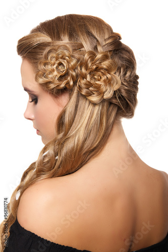 Fototapeta portrait of a beautiful young blonde woman on a light background with hairdo on her head. copy space.
