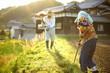 mowing persons in rural area - 地方の農家で草刈りをする高齢者夫婦