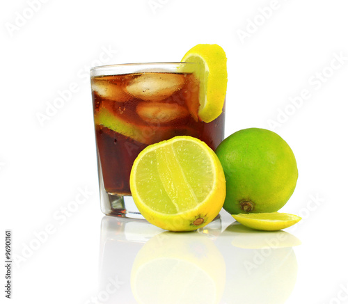 Cocktail with whisky, cola and fresh lime isolated on white background