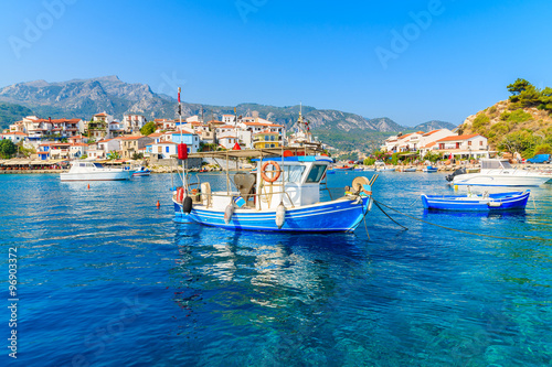 Typical blue and white colour fishing boat in Kokkari port, Samos island, Greece