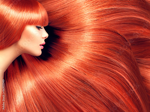 Fototapeta Beautiful hair. Beauty woman with long red hair as background