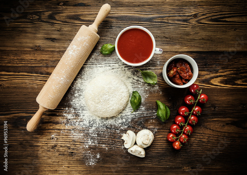 Plagát, Obraz Pizza dough with ingredients on wood