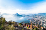 Panoramic view of Lake Lugano with light fog from Monte Bre, Switzerland