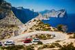 Obrazy na płótnie, fototapety, zdjęcia, fotoobrazy drukowane : winding road with parked cars on the Cap de Formentor