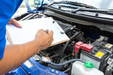 Mechanic man holding clipboard and check the car - Fine Art prints