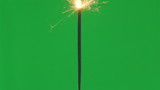 Firework sparkler burning  on green screen background