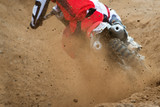 Fototapety Flying debris from a motocross in dirt track