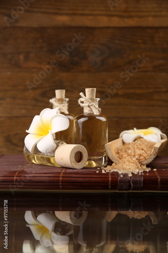 Relax set on the table against wooden background © Africa Studio