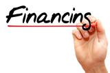 Hand writing FINANCING with marker, business concept