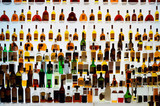 Various alcohol bottles in a bar