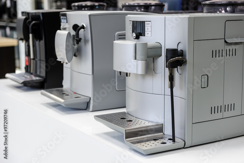 Poster row of coffee machines