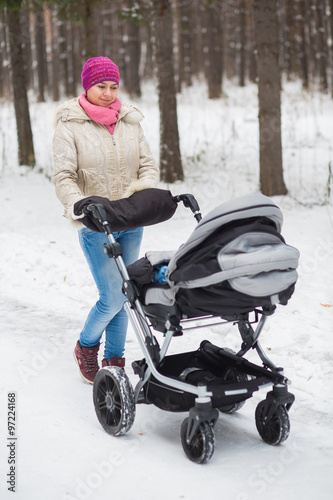 Middle eastern woman with stroller