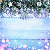 Christmas Garland With Bow And Silver Ornament On Wooden Background
