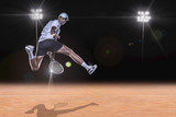 Tennis player reaching for the hard ball