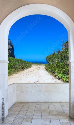 Fototapeta open door arch with access alley