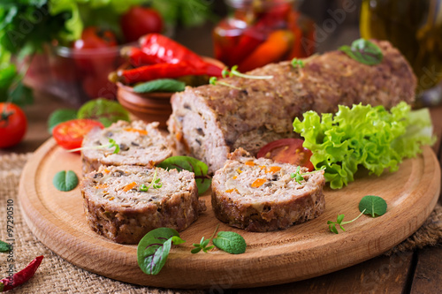 Poster Minced meat loaf roll with mushrooms and carrots