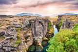 Cliffs and deep fissure in Thingvellir National Park, southern I