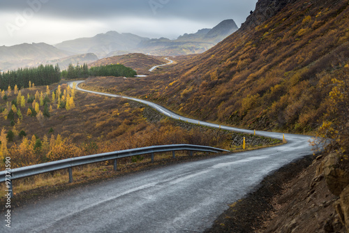 Poster The road line perspevtive direct in to mountain in Autumn season
