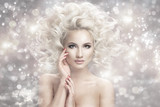 Fototapety Portrait of a woman with blonde hair with light