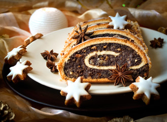 Christmas poppy seed cake on a plate with decoration