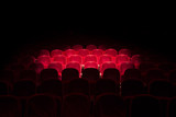 Fototapety Lights on red seats in a theater