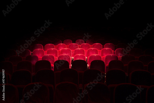 Lights on red seats in a theater Poster