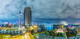 Ho Chi Minh City, Vietnam - September 2nd, 2015: architectural city at night with lights on skyscrapers confluence three rivers present developed full life in Ho Chi Minh City, Vietnam.