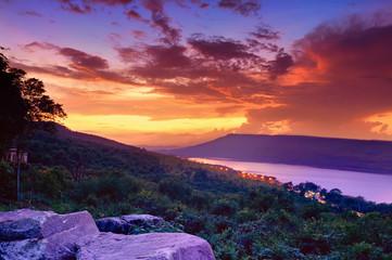 Dramatic sunset over lake at Lam Ta Khong Reservoir, Nakhon Ratchasima province, Thailand.