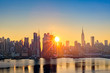 Midtown Manhattan skyline at sunrise, as viewed from Weehawken, along the 42nd street canyon