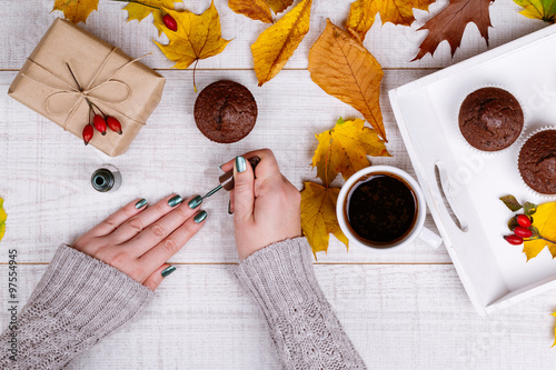 Woman having manicure on a wooden rustic table © tamara83