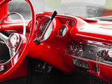 Close-up of red steering wheel of shiny classic vintage car