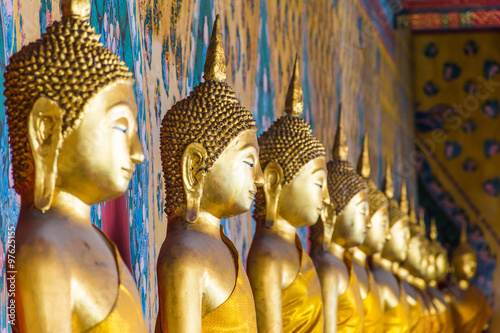 Poster Row of Buddha statues
