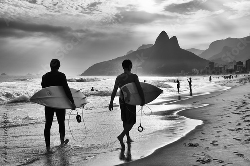 Scenic black and white view of Rio de Janeiro, Brazil with Brazilian surfers wal Poster