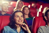 happy friends watching movie in theater - 97656171