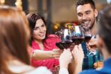 Fototapety friends clinking glasses of wine at restaurant