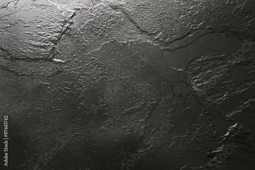 Black stone texture background.