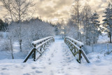 Fototapety Snowy, wooden bridge in a winter day. Stare Juchy, Poland.