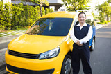 Fototapety portrait of smiling taxi driver with car