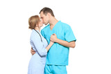 A male and a female doctor kissing at work. love affair at work. isolated on white background